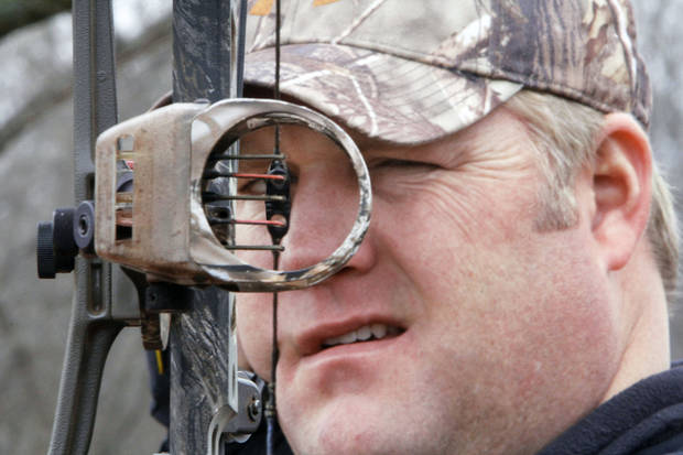 Lane Bruder of Stillwater takes aim through the 3D peep sight that he and bow hunting buddy Victor Borland has invented and are marketing. <strong>PAUL HELLSTERN - Photo by</strong>