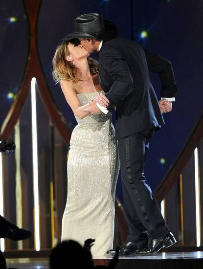 Faith Hill, left, and Tim McGraw kiss on stage at the 49th annual Academy of Country Music Awards at the MGM Grand Garden Arena on Sunday, April 6, 2014, in Las Vegas. (AP)