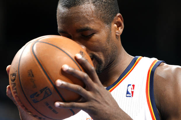Oklahoma City's Serge Ibaka (9) smells the basketball before a free throw during the NBA game between the Oklahoma City Thunder and the Chicago Bulls at Chesapeake Energy Arena in Oklahoma City, Sunday, Feb. 24, 2013. Photo by Sarah Phipps, The Oklahoman