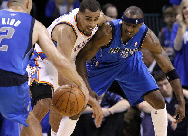 Oklahoma City's Thabo Sefolosha (2) breaks up a pass from Jason Kidd (2) of Dallas and Jason Terry (31) of Dallas during game 3 of the Western Conference Finals of the NBA basketball playoffs between the Dallas Mavericks and the Oklahoma City Thunder at the OKC Arena in downtown Oklahoma City, Saturday, May 21, 2011. Photo by Chris Landsberger, The Oklahoman
