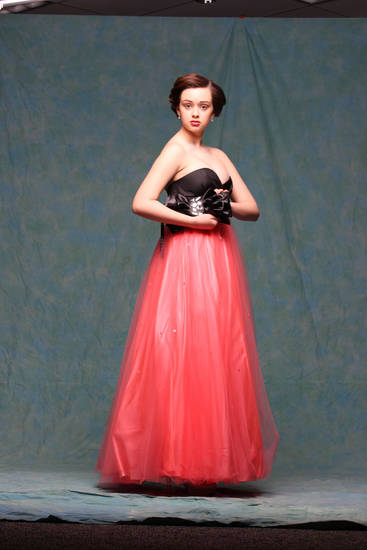 Model  Keely wears a coral-and-black strapless gown with sweetheart neckline from Jump Apparel by Wendye, $219. Photo by Steve Webb, for The Oklahoman. <strong></strong>