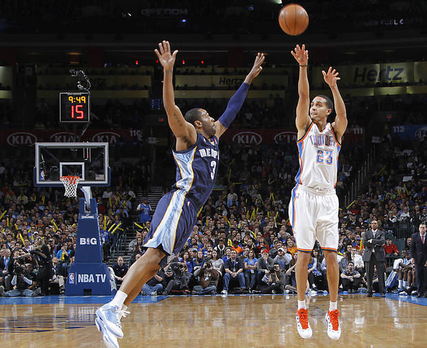 Oklahoma City's Kevin Martin (23) shoots over Memphis' Wayne Ellington (3)  shoots during the NBA basketball game between the Oklahoma City Thunder and the Memphis Grizzlies at Chesapeake Energy Arena on Wednesday, Nov. 14, 2012, in Oklahoma City, Okla.   Photo by Chris Landsberger, The Oklahoman
