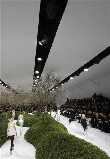 Models present creations by Raf Simons for Christian Dior's Spring Summer 2013 Haute Couture fashion collection, presented in Paris, Monday, Jan.21, 2013. (AP Photo/Christophe Ena)