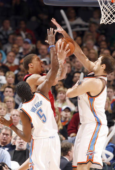 Oklahoma City's Kyle Weaver (5) and Nenad Krstic (12) defend Miami's Michael Beasley during the NBA game between the Oklahoma City Thunder and the Miami Heat Sunday Jan. 18, 2009, at the Ford Center in Oklahoma City. PHOTO BY SARAH PHIPPS, THE OKLAHOMAN