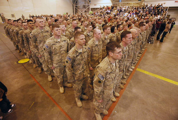 Soldiers from the 45th return from a year's deployment in Afghanistan to waiting family members in Oklahoma City, OK, Saturday, March 3, 2012. By Paul Hellstern, The Oklahoman