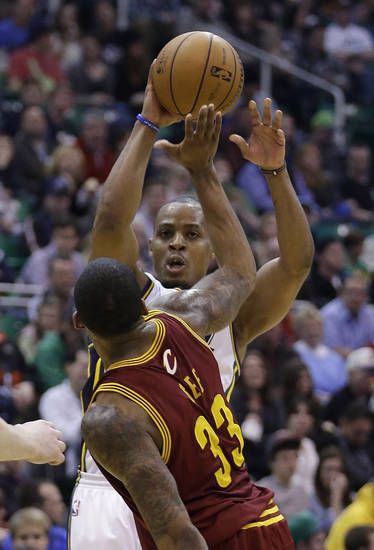 Utah Jazz's Randy Foye, rear, shoots as Cleveland Cavaliers' Alonzo Gee (33) defends in the third quarter during an NBA basketball game Saturday, Jan. 19, 2013, in Salt Lake City. The Jazz defeated the Cavaliers 109-98. (AP Photo/Rick Bowmer)