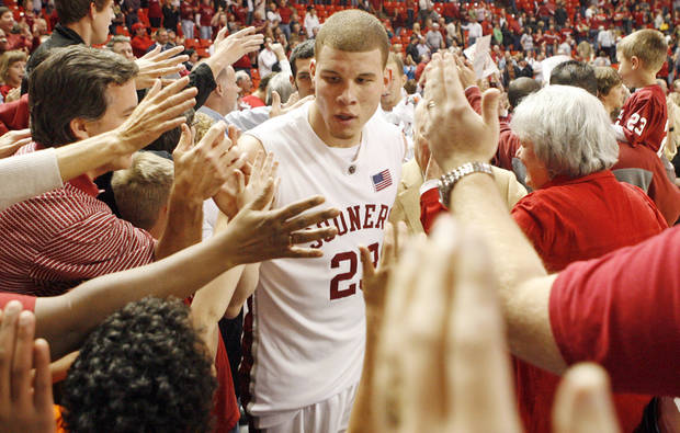 OU's Blake Griffin works his way through a crowd of fans after the men's college basketball game between the University of Oklahoma and Baylor at the Lloyd Noble Center in Norman, Okla., Tuesday, February 19, 2008. OU won in overtime, 92-91. BY NATE BILLINGS, THE OKLAHOMAN