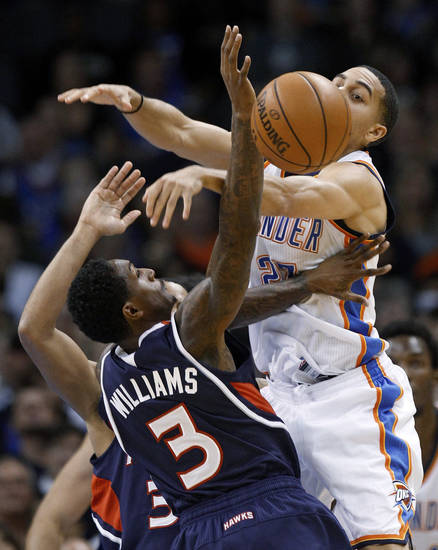 Atlanta Hawks guard Louis Williams (3) knocks the ball away from Oklahoma City Thunder guard Kevin Martin, right, during the second quarter of an NBA basketball game in Oklahoma City, Sunday, Nov. 4, 2012. (AP Photo/Sue Ogrocki)