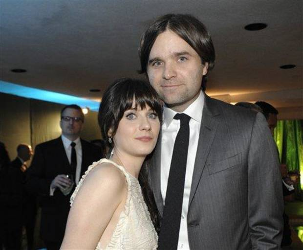 FILE - In this Jan. 16, 2011 file photo, actress Zooey Deschanel, left, and her husband, singer Ben Gibbard attend the 2011 HBO Golden Globe Party in Beverly Hills, Calif. Court records show a Los Angeles judge finalized the former couple&#039;s divorce on Wednesday Dec. 12, 2012. The pair were married in 2009 and separated in October 2011. (AP Photo/Dan Steinberg, file)