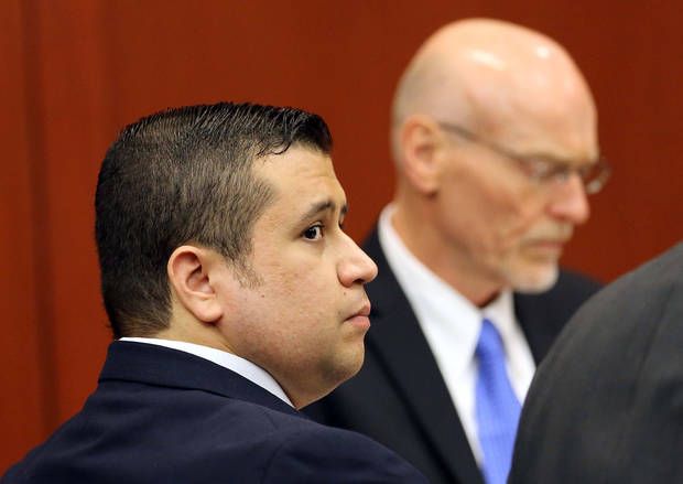 George Zimmerman, left, watches with co-counsel Don West in Seminole circuit court during jury selection in Zimmerman's trial, in Sanford, Fla., Tuesday, June 11, 2013. Zimmerman has been charged with second-degree murder for the 2012 shooting death of Trayvon Martin.(AP Photo/Orlando Sentinel, Joe Burbank, Pool)