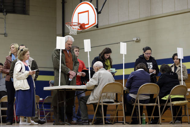 Voters check in at the Eakin Elementary School gymnasium on election day on Tuesday, Nov. 6, 2012, in Nashville, Tenn. After a grinding presidential campaign President Barack Obama and Republican presidential candidate, former Massachusetts Gov. Mitt Romney, yield center stage to American voters Tuesday for an Election Day choice that will frame the contours of government and the nation for years to come. (AP Photo/Mark Humphrey)