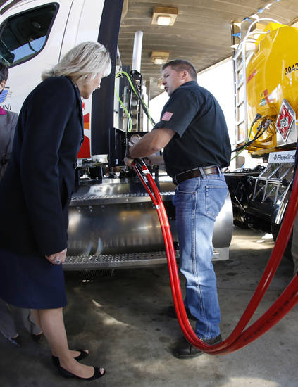"Governor Marry Fallin, left watches Gemini Motor Transport driver Robert Felts demonstrate how to fill his truck with compressed natural gas during the opening of Love's Travel Stops first ""fast fill"" CNG facility for heavy-duty trucks at I-40 and Morgan Road in Oklahoma City, Monday  October 8, 2012. Photo By Steve Gooch, The Oklahoman"