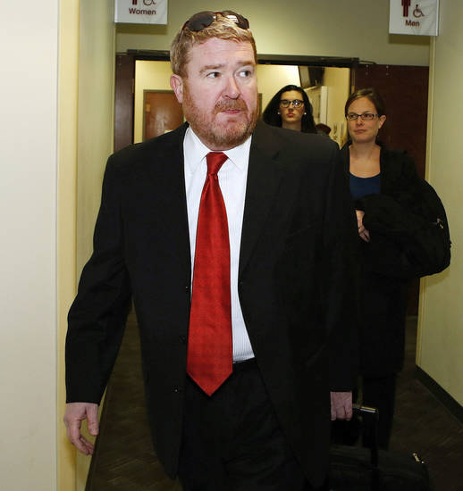 Defense attorney Daniel King leads his team to court for a preliminary hearing for Aurora theater shooting suspect James Holmes at the courthouse in Centennial, Colo., on Monday, Jan. 7, 2013. Holmes is charged with more than 160 counts, including murder and attempted murder after a bloody rampage in a Colorado movie theater left 12 people dead.  (AP Photo/Ed Andrieski)