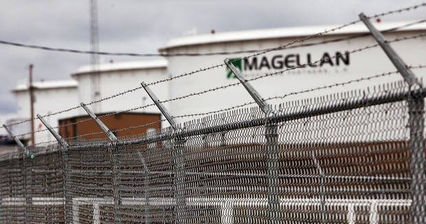 Security fences surround the perimeter of a Magellan oil storage tank facility south of Cushing.   Photo by Jim Beckel, The Oklahoman
