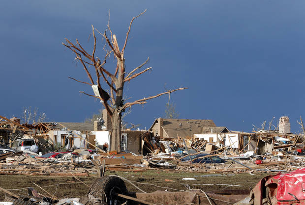 Homes, trees and automobiles damaged by Monday's tornado are seen by early morning light near Telephone road and SW 4th Street on Tuesday, May 21, 2013 in Moore, Okla. Photo by Steve Sisney, The Oklahoman