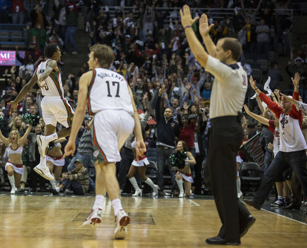 Milwaukee Bucks' Brandon Jennings, left, reacts to his game winning shot at the buzzer to defeat the Cleveland Cavaliers 105-102 in the second half of an NBA basketball game, Saturday Nov. 3, 2012 in Milwaukee. (AP Photo/Tom Lynn)
