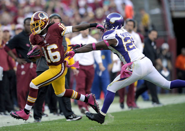 Washington Redskins wide receiver Brandon Banks (16) is pushed out of bounds by Minnesota Vikings cornerback Antoine Winfield (26) during the first half of an NFL football game, Sunday, Oct. 14, 2012, in Landover, Md. (AP Photo/Cliff Owen)