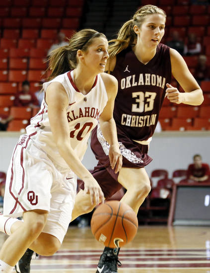 OU's Morgan Hook (10) drives the ball past Andee Wayne (33) of Oklahoma Christian during a women's college basketball exhibition game between the University of Oklahoma and Oklahoma Christian University at the Lloyd Noble Center in Norman, Okla., Thursday, Nov. 1, 2012. Photo by Nate Billings, The Oklahoman