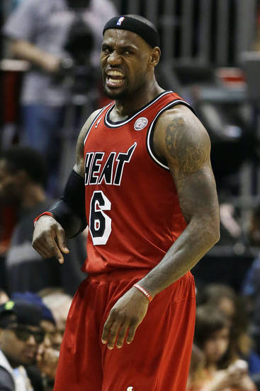 Miami Heat forward LeBron James (6) reacts in the first half of an NBA basketball game against the Atlanta Hawks, Wednesday, Feb. 20, 2013, in Atlanta. (AP Photo/John Bazemore)