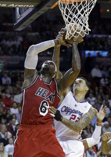 Miami Heat&#039;s LeBron James (6) is fouled by Los Angeles Clippers&#039; Matt Barnes (22) during the second half of an NBA basketball game in Miami, Friday, Feb. 8, 2013. The Heat won 111-89. (AP Photo/Alan Diaz)