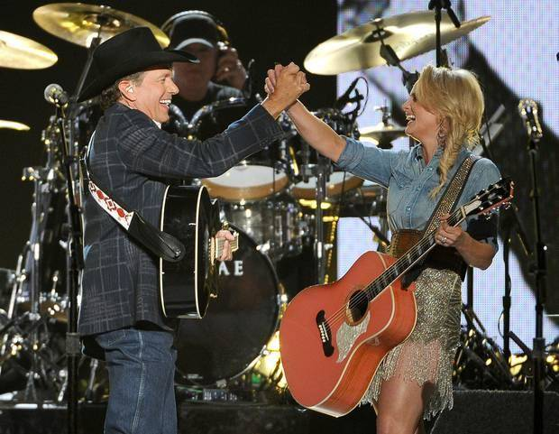 George Strait, left, and Tishomingo resident Miranda Lambert perform on stage at the 49th annual Academy of Country Music Awards at the MGM Grand Garden Arena on Sunday, April 6, 2014, in Las Vegas. (AP)