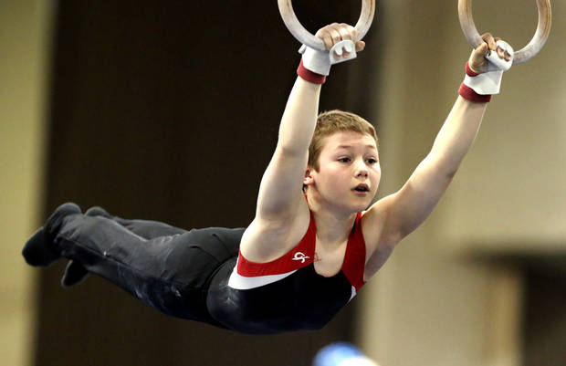 Michael Finney, 12, competes on the rings at the Bart Connor Invitational on Saturday, Feb. 16, 2013  in Oklahoma City, Okla. Photo by Steve Sisney, The Oklahoman