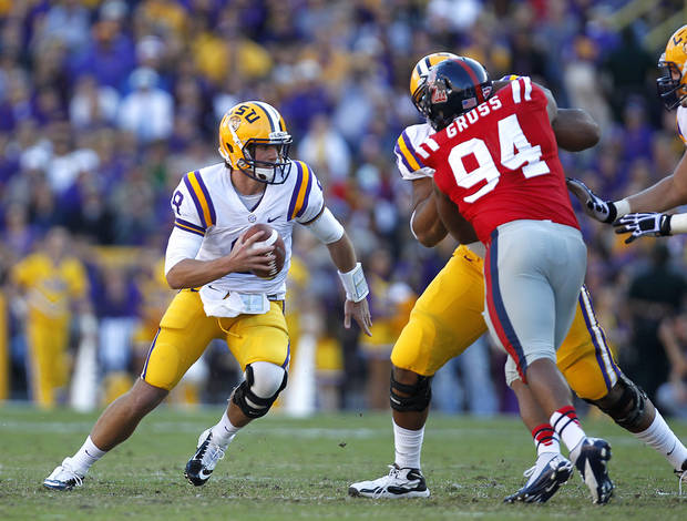 LSU quarterback Zach Mettenberger (8) scrambles pastMississippi defensive lineman Issac Gross (94) in the first half of an NCAA college football game in Baton Rouge, La., Saturday, Nov. 17, 2012. (AP Photo/Gerald Herbert)
