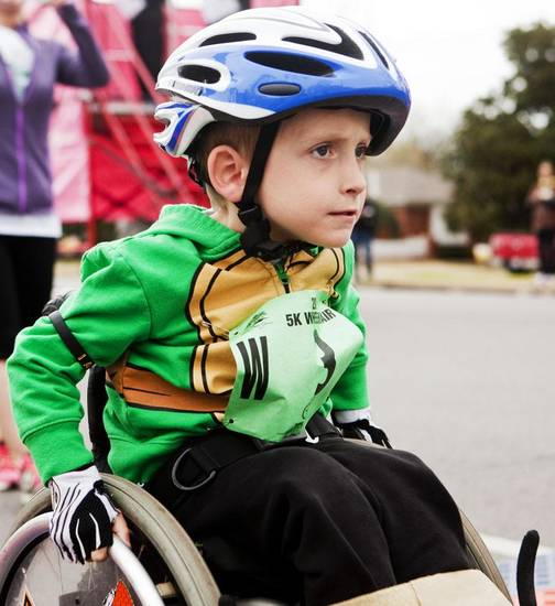 A close up of four-year-old Ryder Gibson and his ninja turtle jacket as he pushes off the starting line of the Redbud Classic at Nichols Hills Plaza in Nichols Hills, OK, Sunday, April 6, 2014. Photo by KT King, The Oklahoman