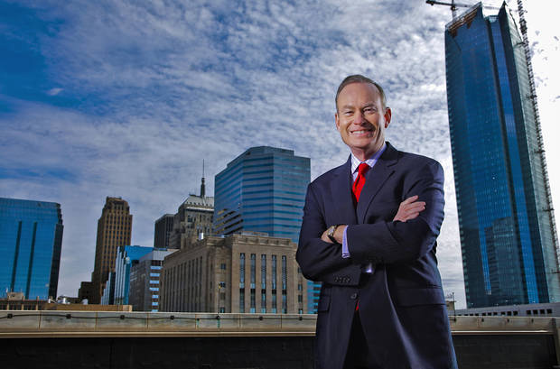 Oklahoma City Mayor Mick Cornett poses for a photo in front of the new look Oklahoma City skyline on Friday, Jan. 13, 2012, in Oklahoma City, Okla. Cornett has played a major roll in transforming the new look of downtown. Photo by Chris Landsberger, The Oklahoman
