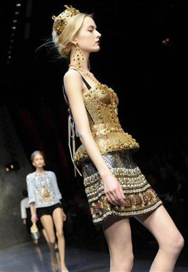A model wears a creation for Dolce &amp; Gabbana women&#039;s Fall-Winter 2013-14 collection, part of the Milan Fashion Week, unveiled in Milan, Italy, Sunday, Feb. 24, 2013. (AP Photo/Giuseppe Aresu)