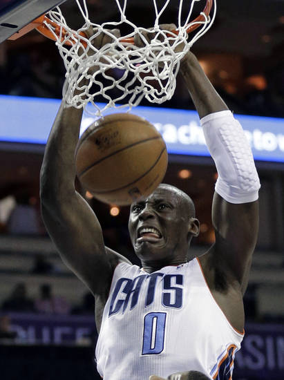 Charlotte Bobcats' Bismack Biyombo (0) dunks against the Atlanta Hawks during the first half of an NBA basketball game in Charlotte, N.C., Wednesday, Jan. 23, 2013. (AP Photo/Chuck Burton)