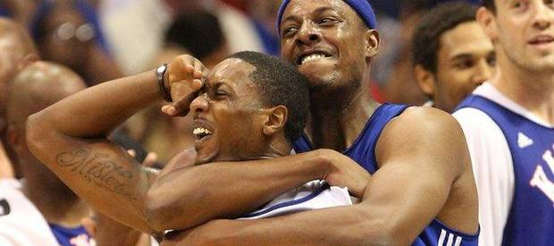 "Boston's Paul Pierce, left, playfully chokes Miami's Mario Chalmers after Chalmers hit a 3-pointer with 0.1 seconds left, which forced the ""Legends of the Phog"" exhibition game to end in a 111-111 tie Saturday inside soldout Allen Fieldhouse. (Photo by Richard Gwin, Lawrence Journal-World)"