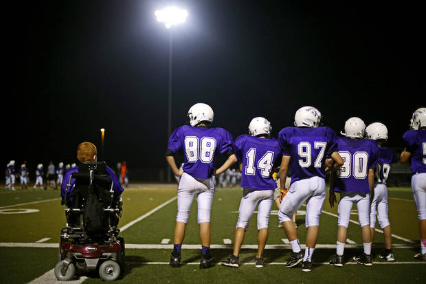 Keegan Erbst watches from sidelines during a Sequoyah Middle School football game, Thursday, September 27, 2012. Keegan, who has muscular dystrophy and is confined to a wheelchair, got involved with the team after players Lucas Coker, Colton James, and Parker Tumleson, pushed suggested it to the coach.  Photo by Bryan Terry, The Oklahoman