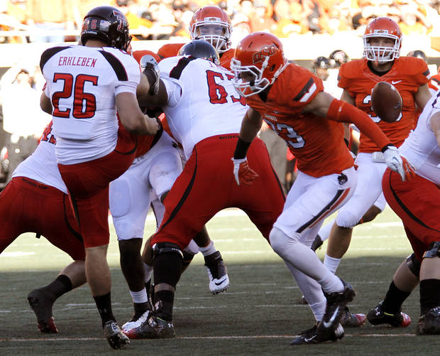 Oklahoma State&#039;s Zack Craig (23) blocks a kick by Texas Tech&#039;s Ryan Erxleben (26) during the college football game between the Oklahoma State University Cowboys (OSU) and Texas Tech University Red Raiders (TTU) at Boone Pickens Stadium on Saturday, Nov. 17, 2012, in Stillwater, Okla.   Photo by Chris Landsberger, The Oklahoman