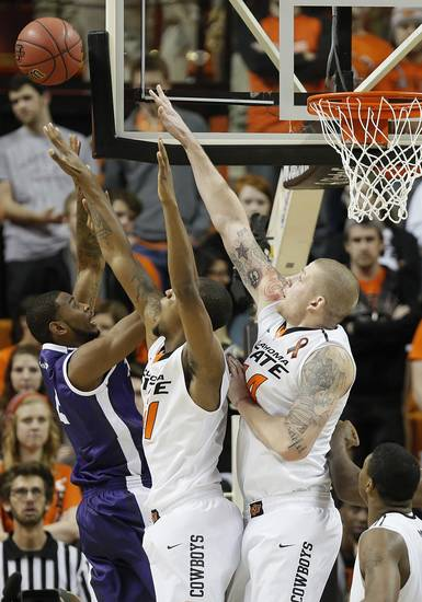 Oklahoma State's Kamari Murphy (21) and Philip Jurick (44) defend TCU's Connell Crossland (2) during the college basketball game between Oklahoma State University Cowboys (OSU) and Texas Christian University Horned Frogs (TCU) at Gallagher-Iba Arena on Wednesday Jan. 9, 2013, in Stillwater, Okla. 