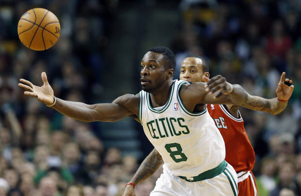 Boston Celtics' Jeff Green (8) reaches for a loose ball in front of Milwaukee Bucks' Monta Ellis in the first quarter of an NBA basketball game in Boston, Friday, Dec. 21, 2012. (AP Photo/Michael Dwyer)