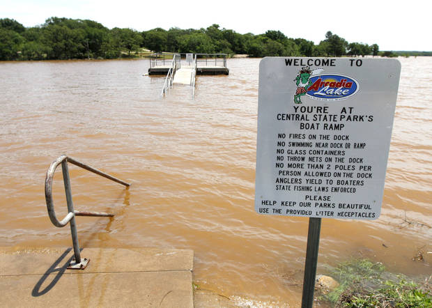 The boat dock and fishing pier were submerged in Central State Park at Arcadia Lake after storms dumped up to eight inches of rain on May 31.  Photo by Paul Hellstern, The Oklahoman <strong>PAUL HELLSTERN - Oklahoman</strong>