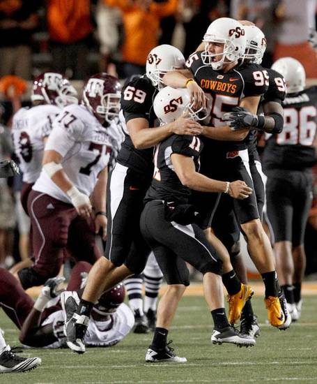 OSU's Dan Bailey celebrates after making the game-winning field goal during the college football game between Texas A&M University and Oklahoma State University at Boone Pickens Stadium in Stillwater, Okla., Thursday, Sept. 30, 2010. Photo by Bryan Terry, The Oklahoman