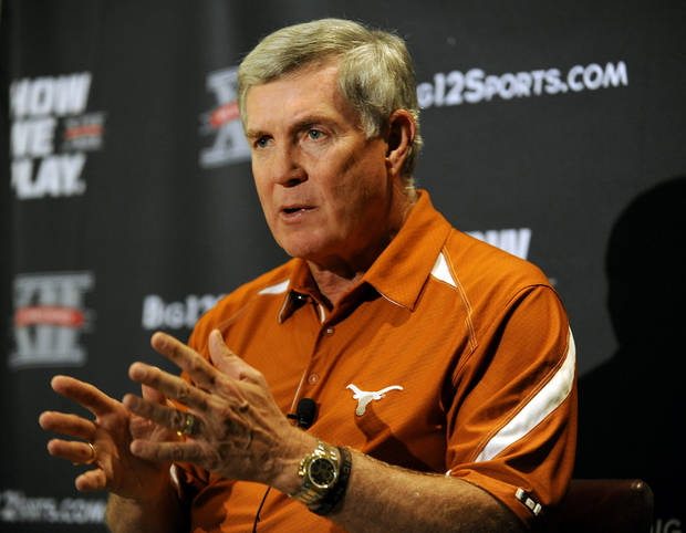 Texas head coach Mack Brown answers questions during NCAA college football Big 12 Media Days, Monday, July 25, 2011, in Dallas. (AP Photo/Matt Strasen)