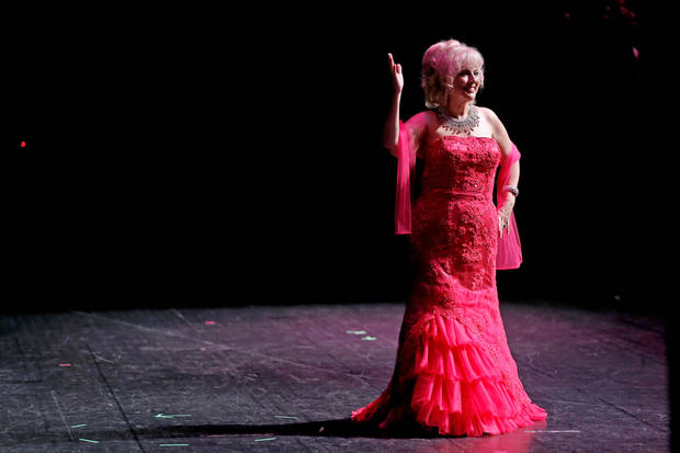 Dot Liles of Oklahoma City waves to the crowd during the evening dress portion of the Ms. Oklahoma Senior America Pageant. Photo by Bryan Terry, The Oklahoman