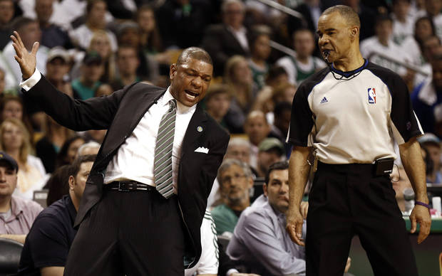 Boston Celtics' Doc Rivers complains about a call to the referee during the fourth quarter of of their 90-76 loss to the New York Knicks in Game 3 of a first round NBA basketball playoff series in Boston Friday, April 26, 2013. (AP Photo/Winslow Townson)