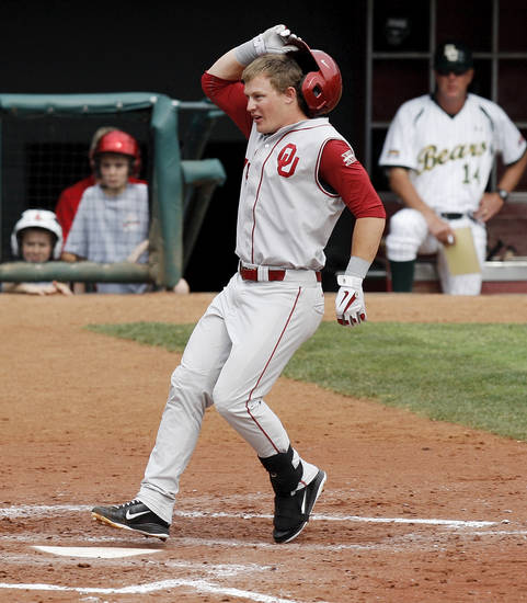 OU's Matt Oberste (14) touches home plate after hitting a home run in the fourth inning during a Big 12 Baseball Championship tournament game between the Oklahoma Sooners and Baylor Bears at the Chickasaw Bricktown Ballpark in Oklahoma City, Saturday, May 26, 2012. OU won, 7-2. Photo by Nate Billings, The Oklahoman