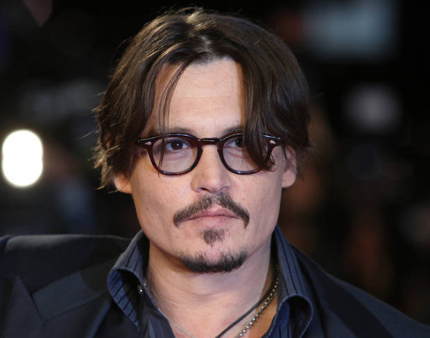 U.S actor Johnny Depp arrives for the European Premiere of  the Rum Diary, at a west London cinema, Thursday, Nov. 3, 2011. (AP Photo/Joel Ryan)