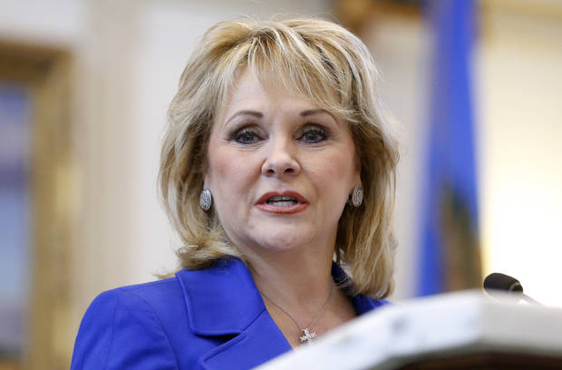 Oklahoma Gov. Mary Fallin delivers her annual State of the State address to lawmakers as the 2013 legislative session gets underway in Oklahoma City, Monday, Feb. 4, 2013. (AP Photo/Sue Ogrocki) ORG XMIT: OKSO103