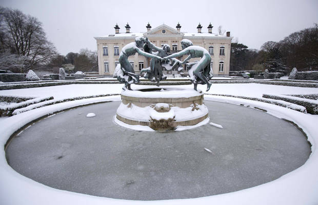 Snow and ice covers a fountain at a public park in Wilrijk, Belgium on Tuesday, Jan. 15, 2013. Belgium experienced the first snow of the season on Tuesday which snarled traffic in early morning rush hour. (AP Photo/Virginia Mayo)
