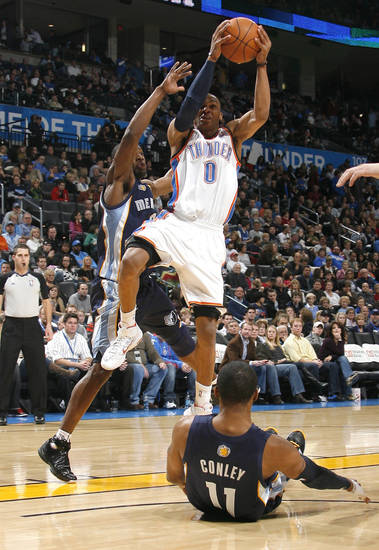 Oklahoma City's Russell Westbrook (0) shoots as Memphis' Tony Allen (9) and Mike Conley (11) defend during the NBA basketball game between the Oklahoma City Thunder and the Memphis Grizzlies, Saturday, Jan. 8, 2011, at the Oklahoma City Arena. Photo by Sarah Phipps, The Oklahoman