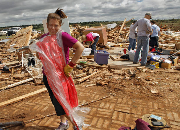 Miranda Lewis makes the best of a bad situation as she models a dress that was undamaged by Tuesday's tornado that destroyed her family's home west of El Reno, Okla., Wednesday, May 25, 2011. (AP Photo/The Oklahoman, Chris Landsberger) ORG XMIT: OKOKL305