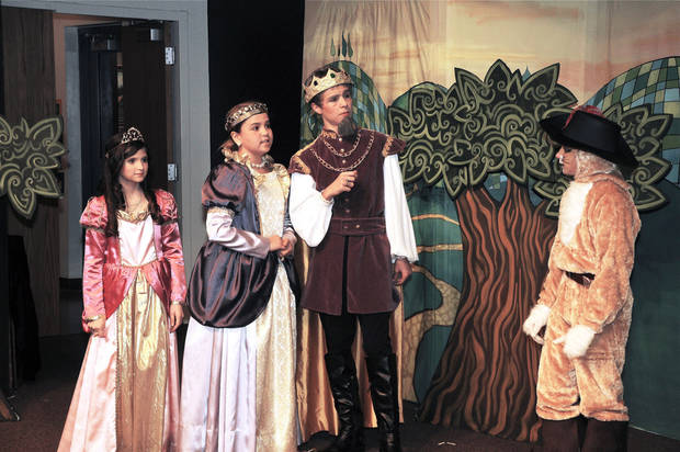 Alyson McLoughlin, Alexandra Gorman, Dylan Scott Carver and Sam Kisthardt rehearse a scene from �Puss in Boots� at the Fine Arts Institute of Edmond.