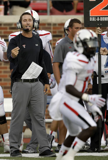 Texas Tech head coach Kliff Kingsbury directs from the sidelines during the first half of a college football game against Southern Methodist, Friday, Aug. 30, 2013, in Dallas. (AP Photo/LM Otero)