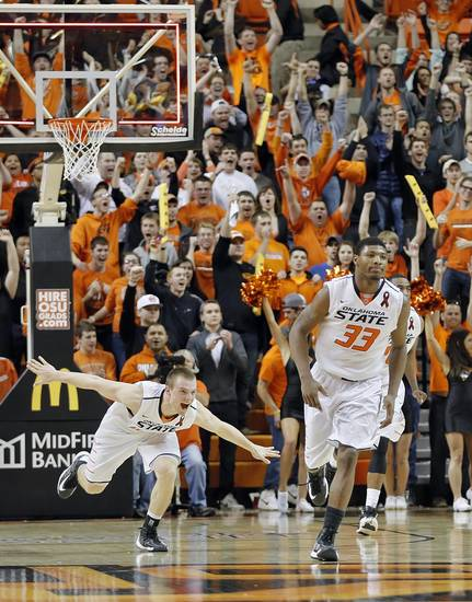 Oklahoma State's Phil Forte (13) and Marcus Smart (33) react with fans in the 78-76 win over Iowa State during the college basketball game between the Oklahoma State University Cowboys (OSU) and the Iowa State University Cyclones (ISU) at Gallagher-Iba Arena on Wednesday, Jan. 30, 2013, in Stillwater, Okla.  Photo by Chris Landsberger, The Oklahoman